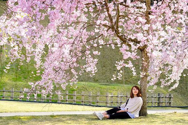 Woman sitting on green